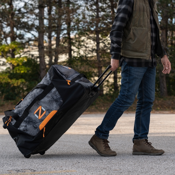 Hunter using oz chamber rolling bag